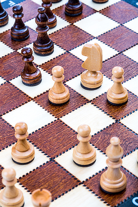 Chess pieces on a board in the middle of a game